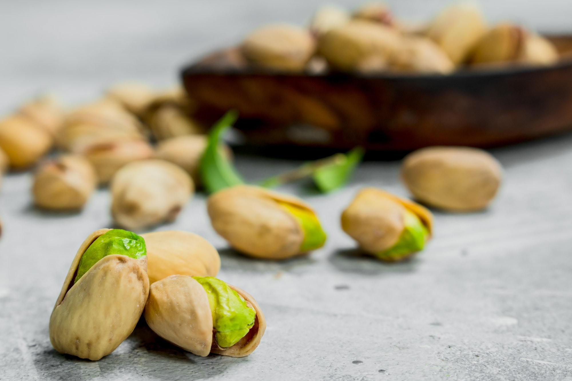 Pistachios with leaves.
